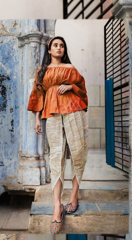 Orange & Cream Top And Bottom Are Fabricated On Khadi Beautified With Prints Western Pair