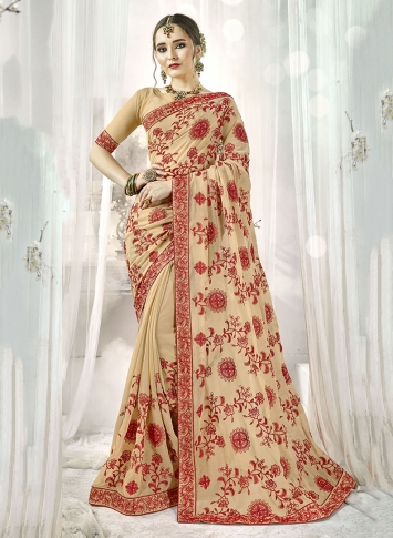 Fancy Georgette Saree In Beige Color Paired With Beige Colored Blouse