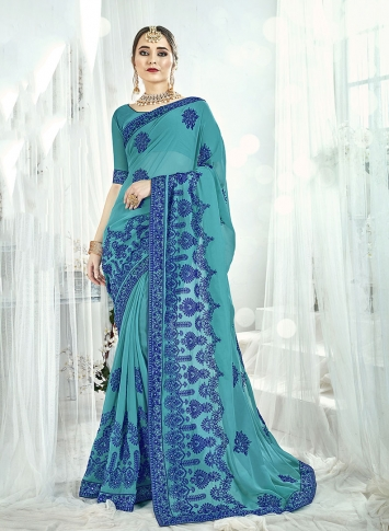 Fancy Georgette Saree In Turquoise Blue Color Paired With Turquoise Blue Colored Blouse