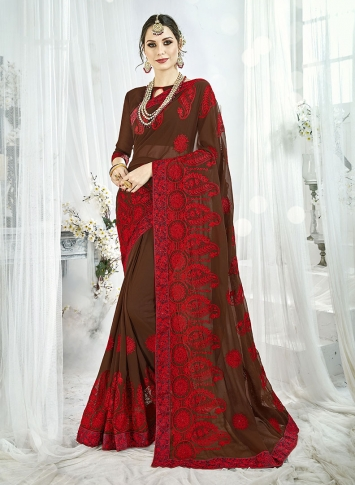 Fancy Georgette Saree In Turquoise Brown Paired With Brown Colored Blouse