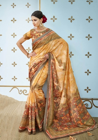 Designer Saree Fabricated On Banarasi Art Silk Beautified With Prints And Stone Work In Orange Colour