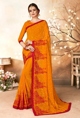 Georgette Saree In Orange Color Paired With Orange Colored Blouse