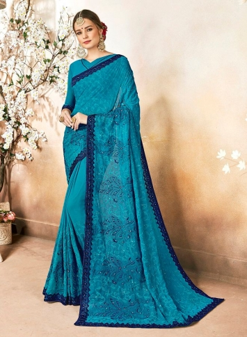 Georgette Saree In Blue Color Paired With Blue Colored Blouse