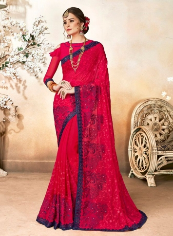 Georgette Saree In Dark Pink Color Paired With Dark Pink Colored Blouse