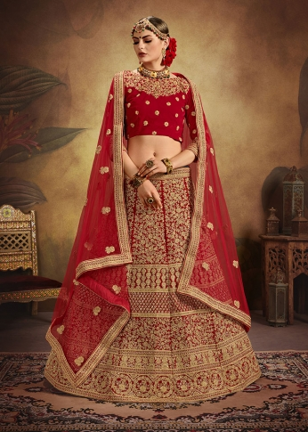 Red Colour Heavy Embroidered Lehenga Choli Is Fabricated On Velvet Paired With Net Fabricated Dupatta