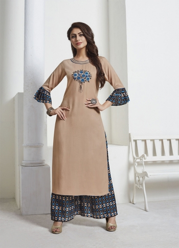 Beige Readymade Kurta Set Paired With Black & Blue Colored Bottom