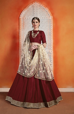 Designer Lehenga Choli Maroon Color Paired With Contrasting Cream Colored Dupatta