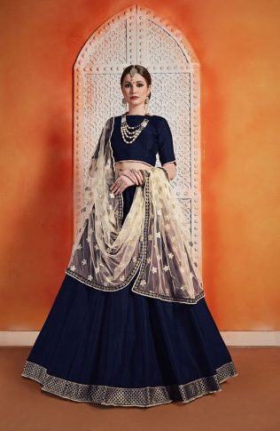 Designer Lehenga Choli Navy Blue Color Paired With Contrasting Cream Colored Dupatta