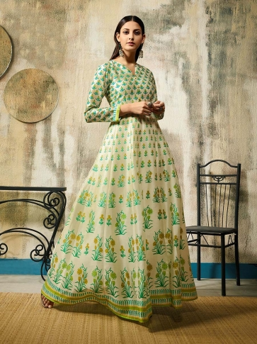 Designer Readymade Gown Is Here In Off-White Color Fabricated On Chanderi