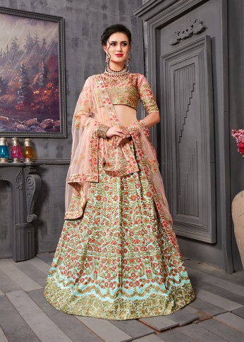 Heavy Embroidered Lehenga Choli IS Fabricated On Art Silk Paired With Net Fabricated Dupatta