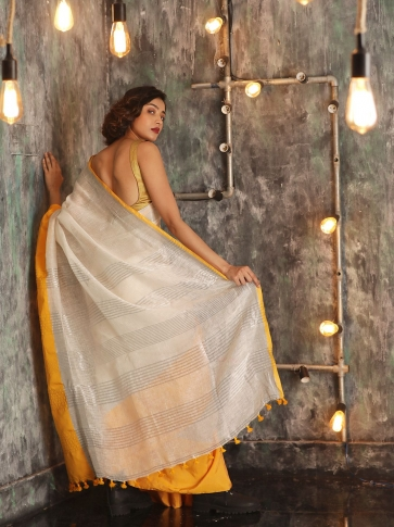 White Hand woven Linen Saree With Yellow Border 1