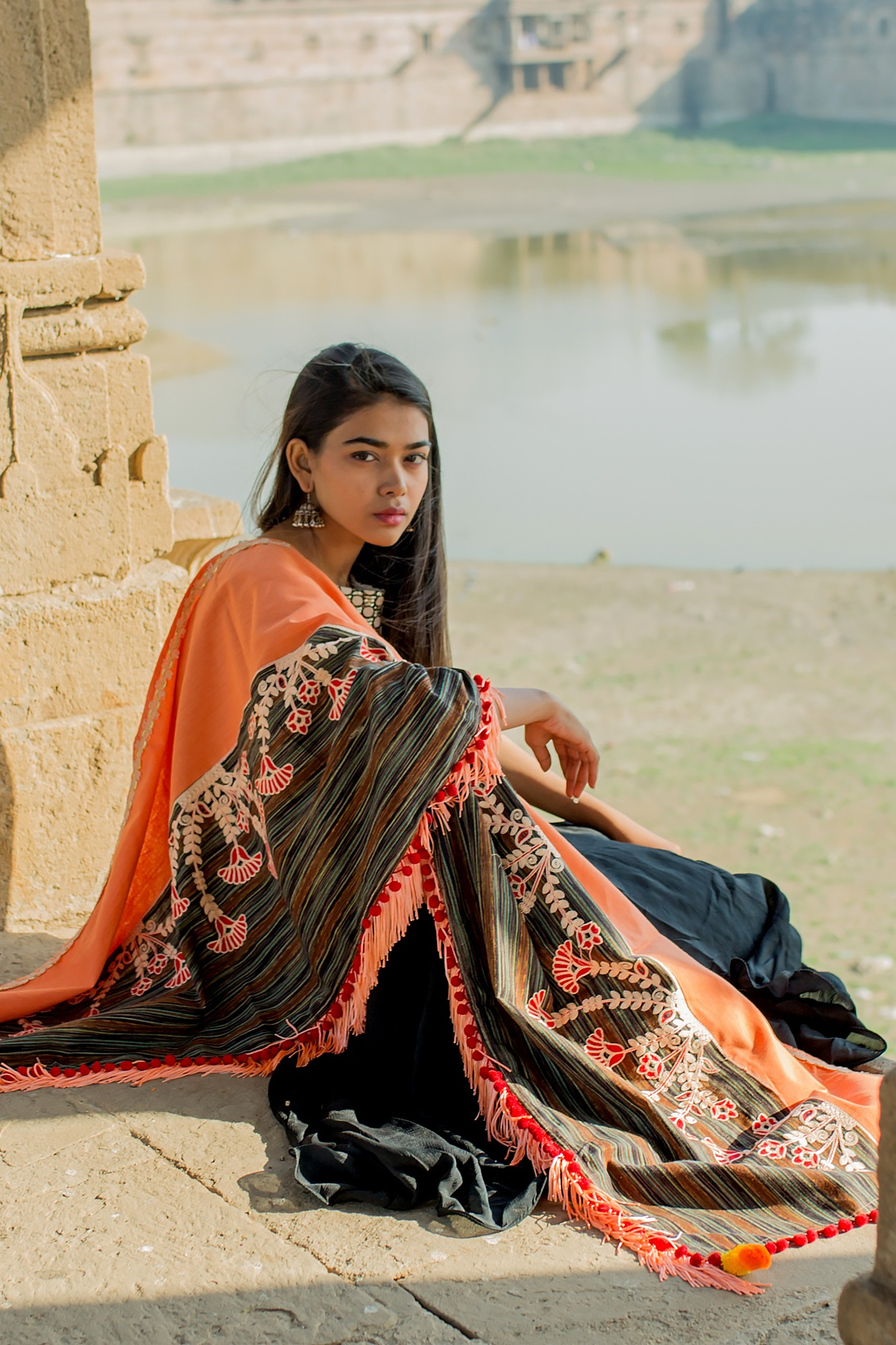 Dupatta In Orange And Multi Color Fabricated On Khadi Cotton Beautified with Thread Work And Pom Pom Laces